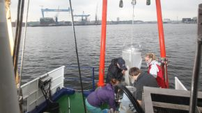 Four researchers on a boat.
